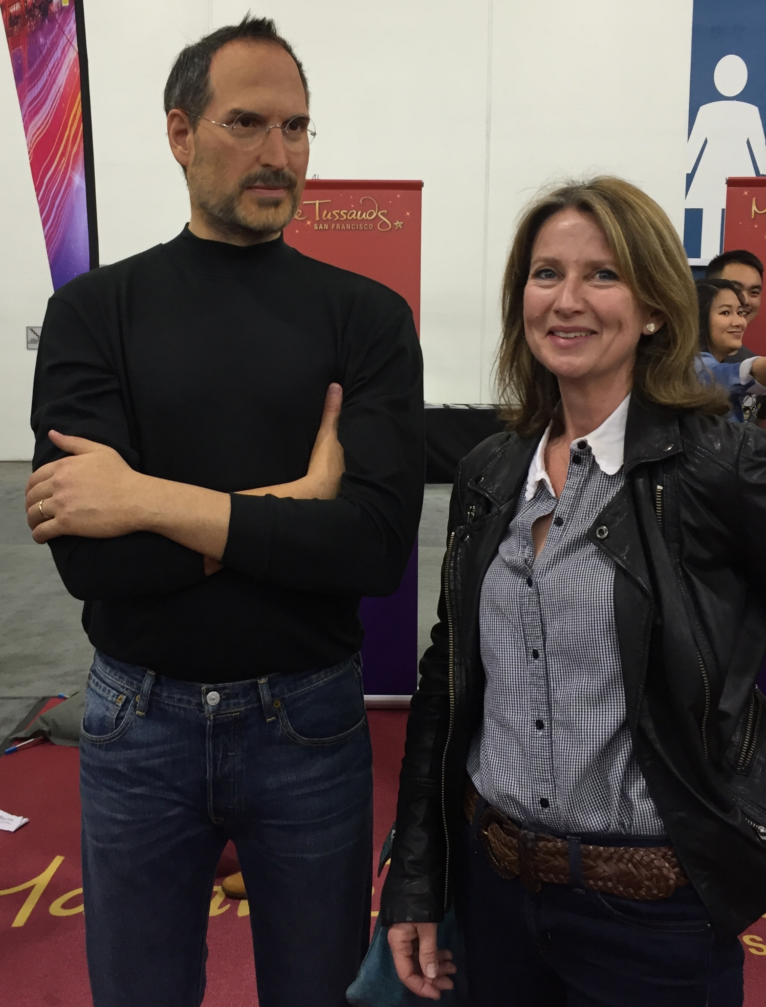 TinkerTech Founder and blog author Claire Comins sharing a joke with a waxwork Steve Jobs. At ComiCon Silicon Valley