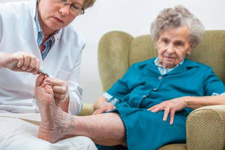 30402737_S_Senior_toenails_clipping_podiatrist_woman_diabetes.jpg