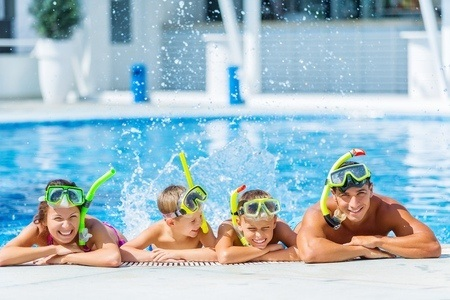 48217024_S_swimming_Family_Pool_Children_Parents_Happy.jpg