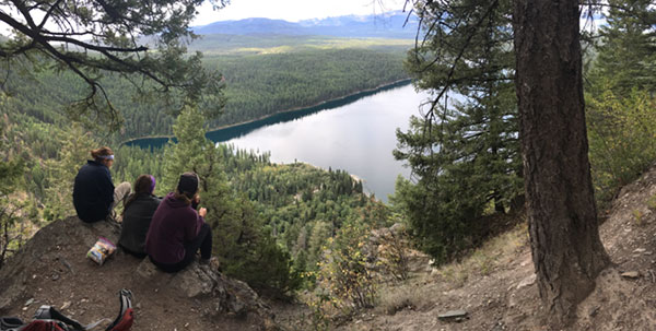 Students enjoy some of the first clear views of Holland Lake on our way up the canyon