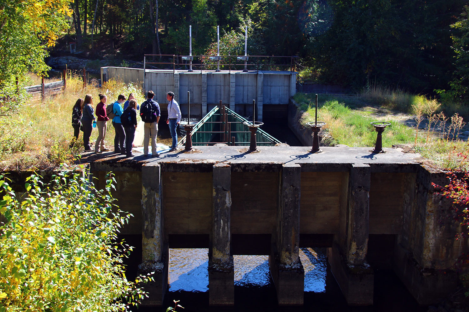 Casey, the Tribal Hydrologist, talking with us about the Flathead Indian Irrigation Project atop a huge head-gate.