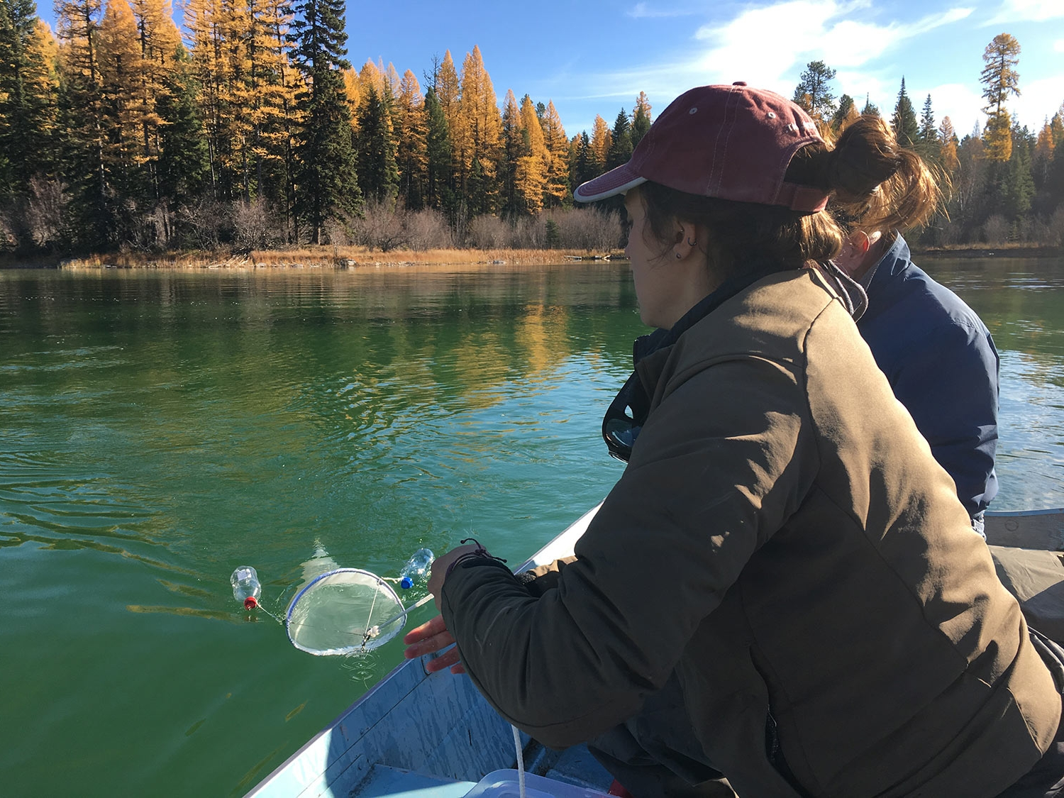 Caitlin Mitchell with Bill Beers monitoring for AIS on Van Lake