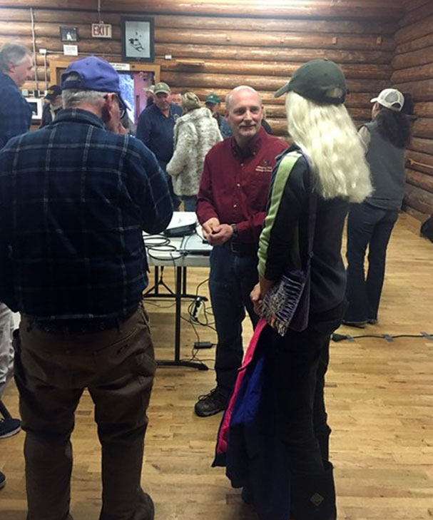 Montana Fish Wildlife and Parks grizzly bear management specialist Tim Manley answering questions with audience members following his presentation