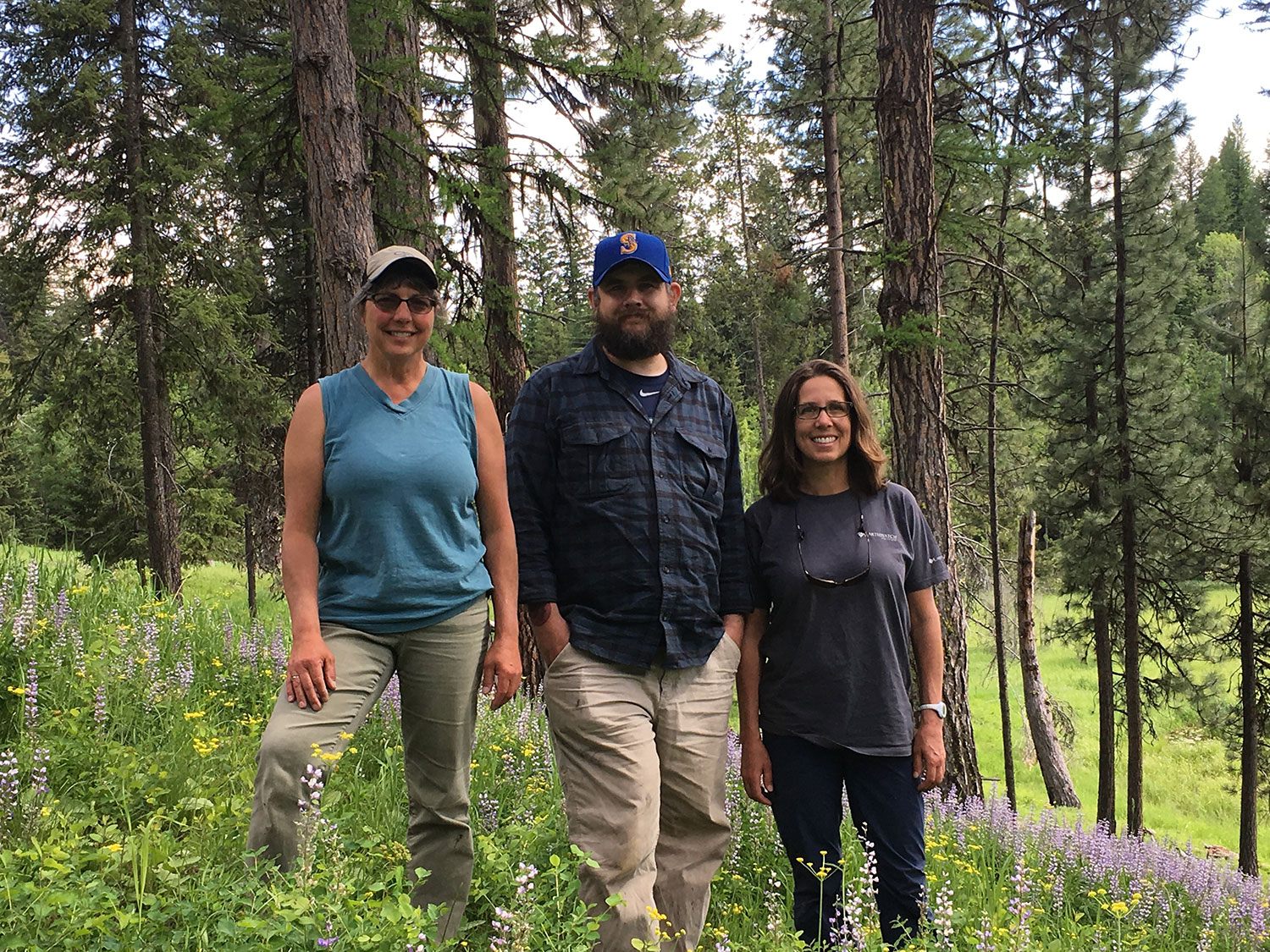 Principal Investigator Maria Mantas with volunteers Kyle Stoddard and Hannah Webber, standing on a lupine-filled slope behind the Old Condon Ranger Station, which provides an awesome lodging opportunity that some of this year's volunteer teams will enjoy. Photo: Rob Rich
