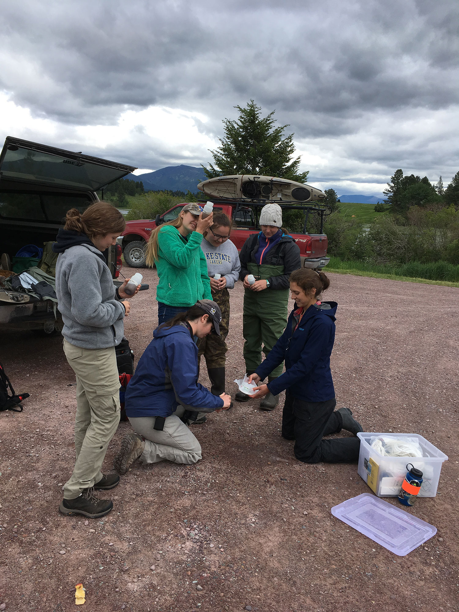 "Students transfer the collected samples to a single ""composite"" sample that is representative of the lake, which will be sent to Montana Fish, Wildlife, & Parks for microscopy analysis. Photo: Rob Rich"