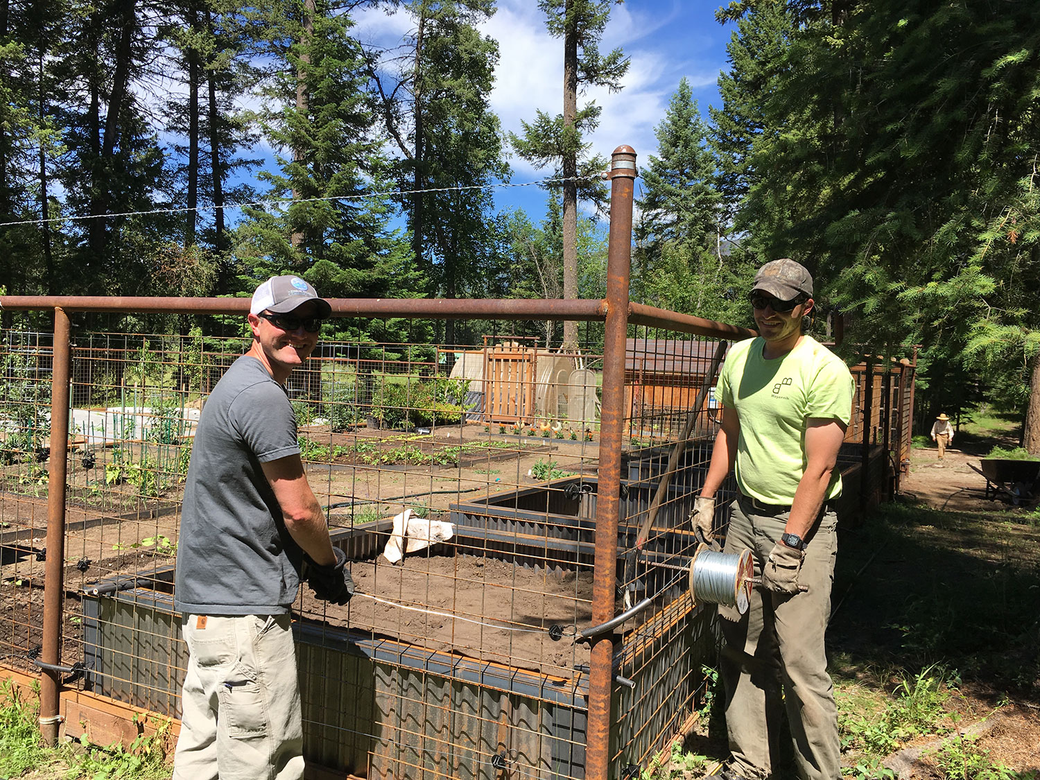 Even as Mike and Luke try to keep the tension around the challenging corners, their grins are apt proof that building a bear fence is also FUN!