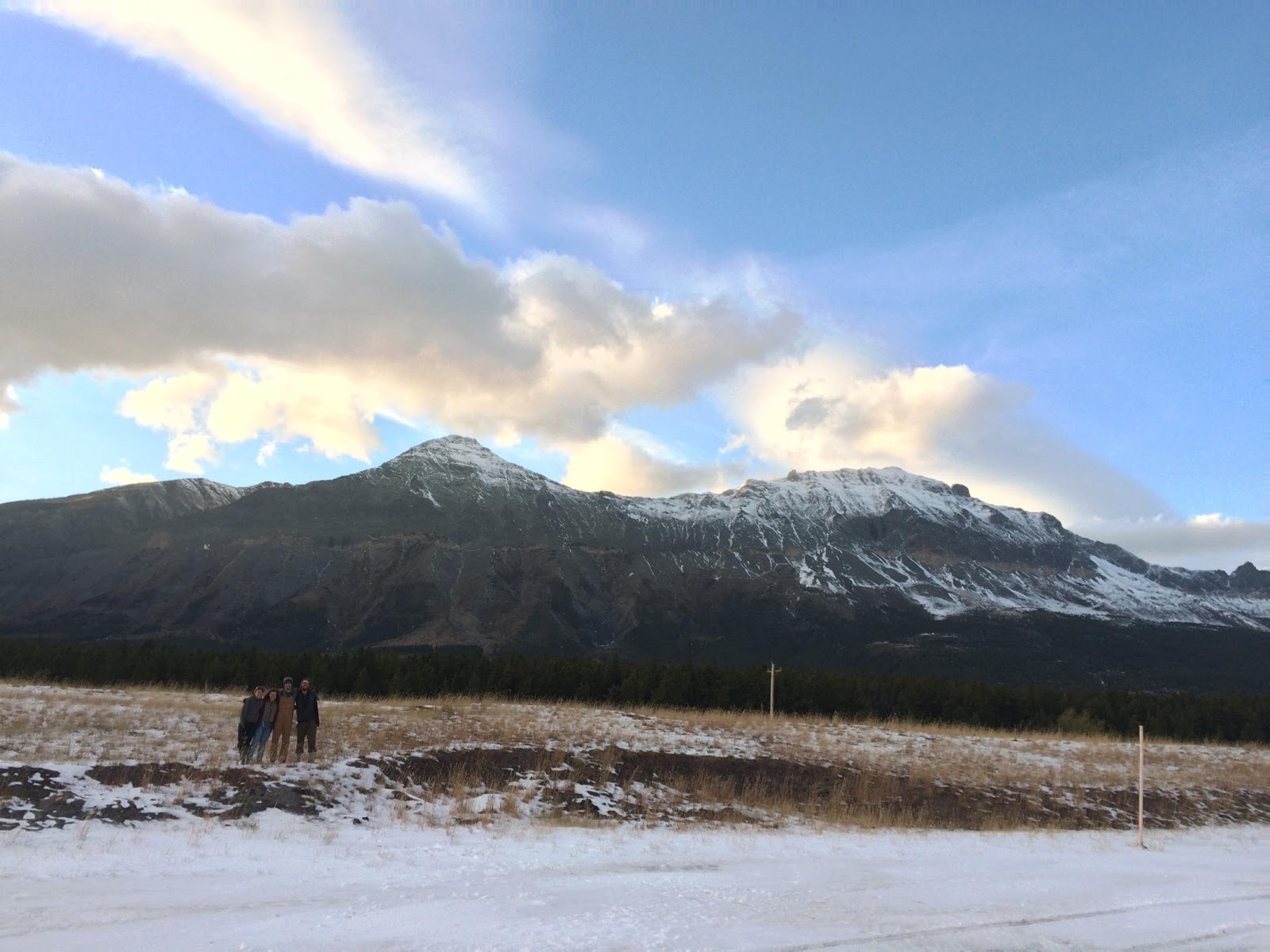 Students and the snowy mountains along the drive from Whitefish to Choteau