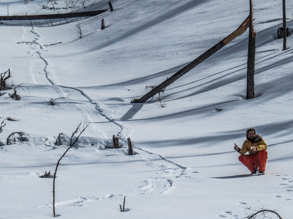 Adam Lieberg next to where a wolverine slid down a slope. Photo by Josh Blouin