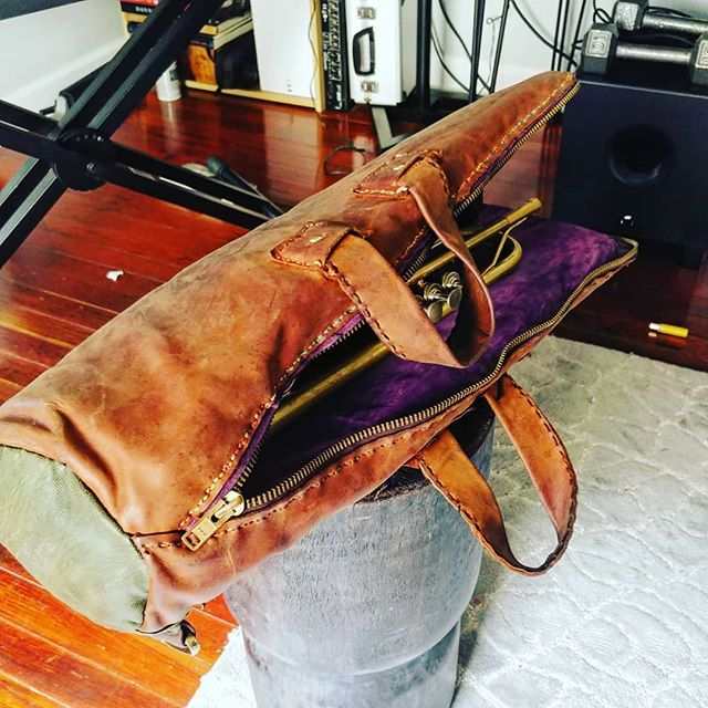 I made this trumpet case completely by hand 2 years ago and this is what it looks like after it's been worn in... It took me about 90 hours to complete from conceptualization to completion. ( didn't really sleep for a few days)  I didn't know anything about leathermaking, or sewing leather by hand, didn't even have a pattern, but I took the first big step which was going to the store and buying all this stuff (a top grain cow hide, a purple suede pig skin, and a turquoise goat skin, and everything needed to put it together). The next big step was making the first cut into the leather.  I wanted everything to be exact and once you cut you can't uncut.  I became completely engulfed in this new challenge.  It was a new way for me to be creative, and there was hardly sleep until this puzzle was finished and I could carry it around like a trophy upon completion.  So many little challenges presented themselves and I had to solve them in my own way to continue.  Most times you recreate the wheel, but even a beginner can innovate.  Einstein wasn't a mathematician, he was struck with curiosity. 👍🏾Try something you've never done before.  It's often scary taking that first step, but you can experience/accomplish🏆 so many amazing things in life.  It's  impossible to know until you try. #innovationkoolaid