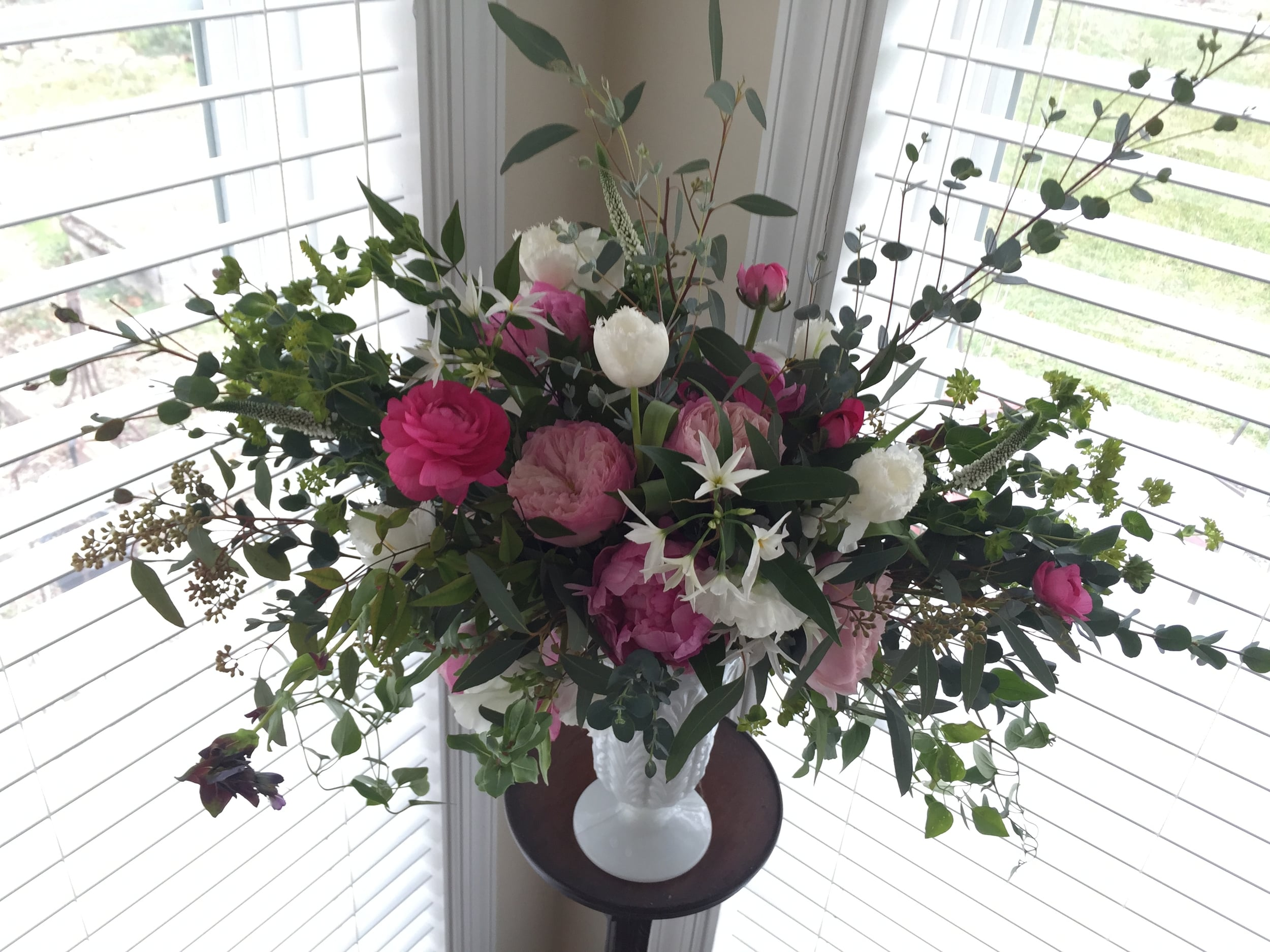 This bridal bouquet looks lovely and doubles as a centerpiece or accent arrangement when placed in this milk glass vase.