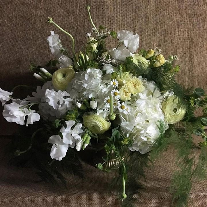 Practicing designs with white hydrangea, ranunculus, roses, chamomile, and sweet peas in a gold compote bowl.