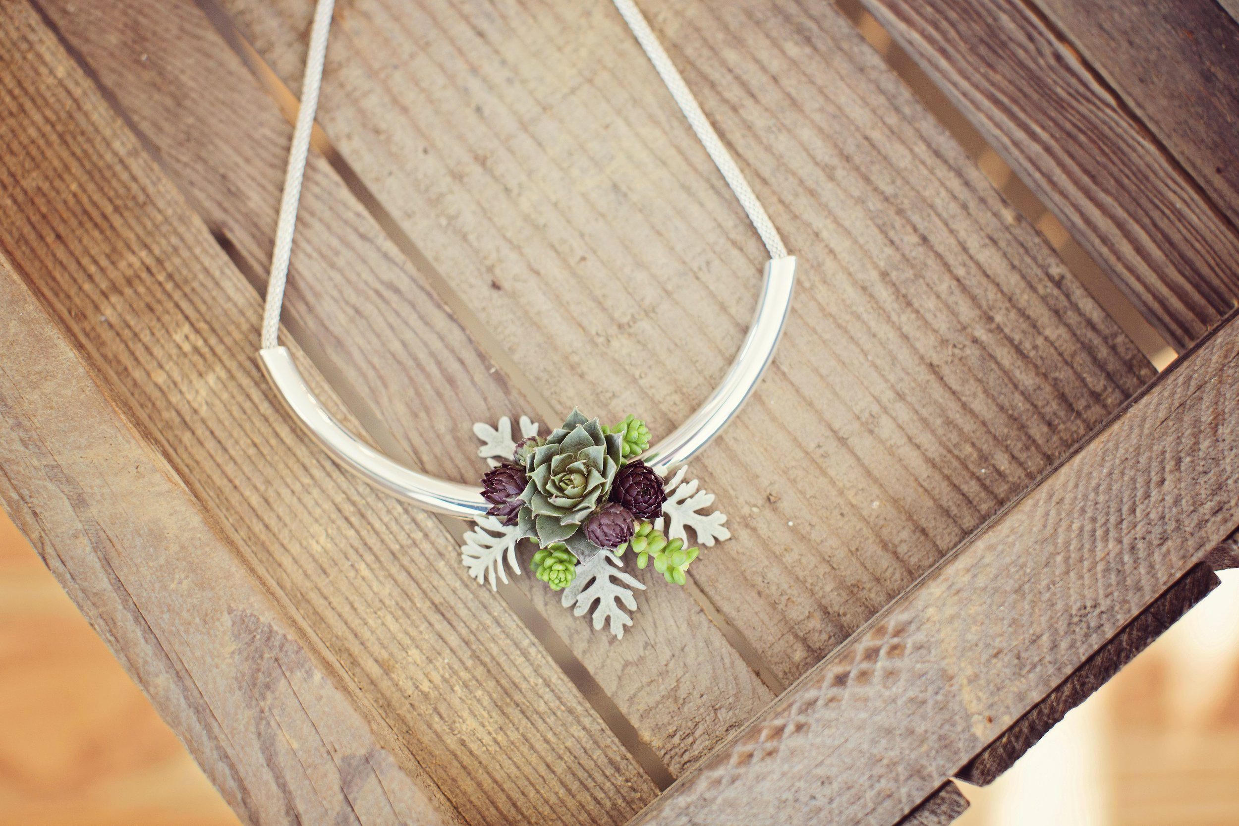 Custom Succulent Necklace $50   Floral necklace custom designed by Westvirjeni with tiny succulents that can last up to 6 months. Wear and then plant to enjoy for years to come.