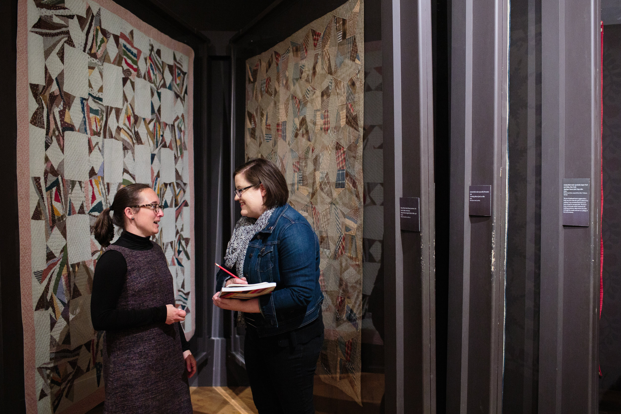 Laura McDowell Hopper interviewing Shelburne Museum Curator Katie Wood Kirchhoff, 2018. Photo by Azuree Wiitala for Quiltfolk magazine.