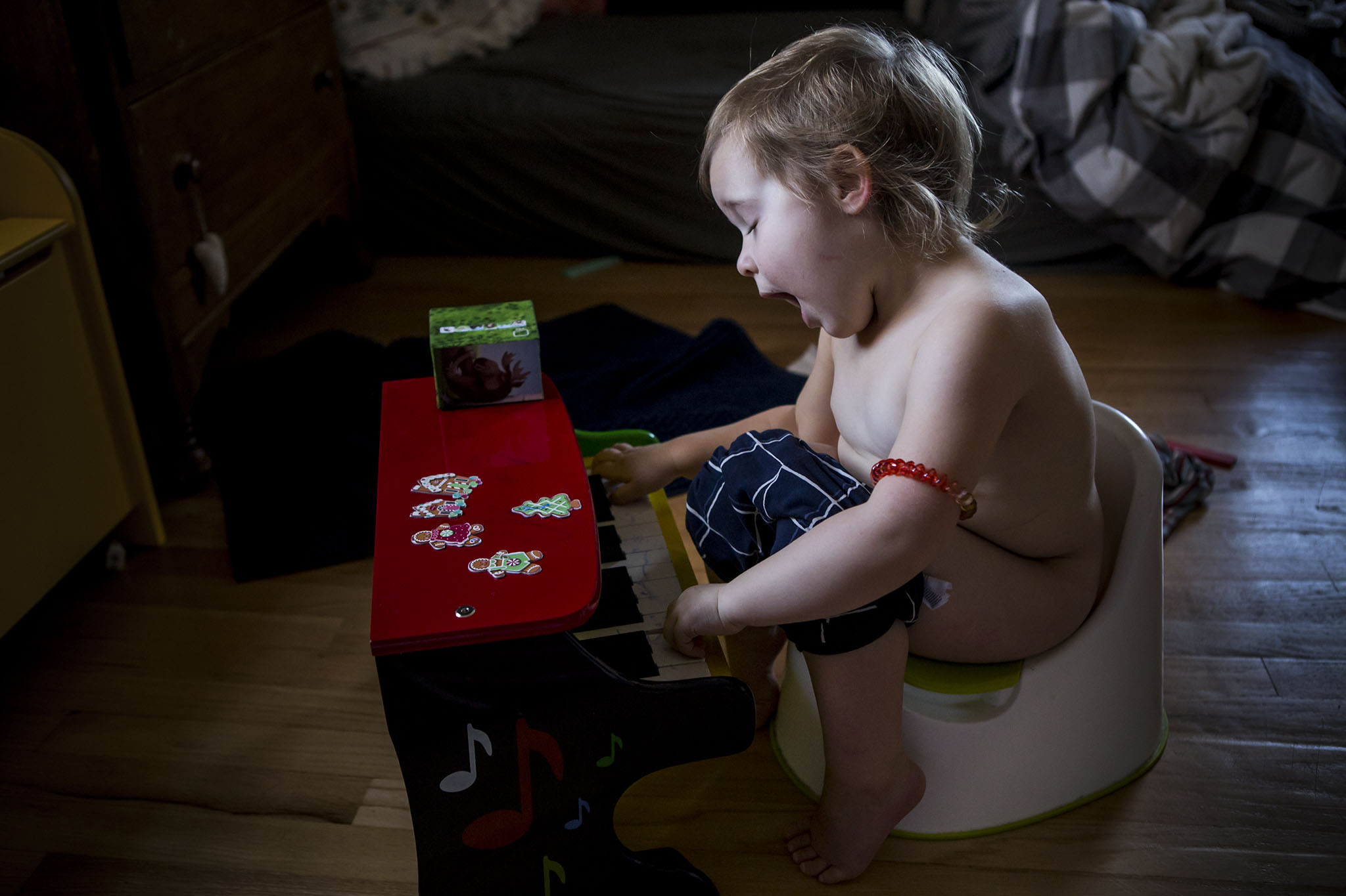 toddler potty training and playing toy piano while singing in CT
