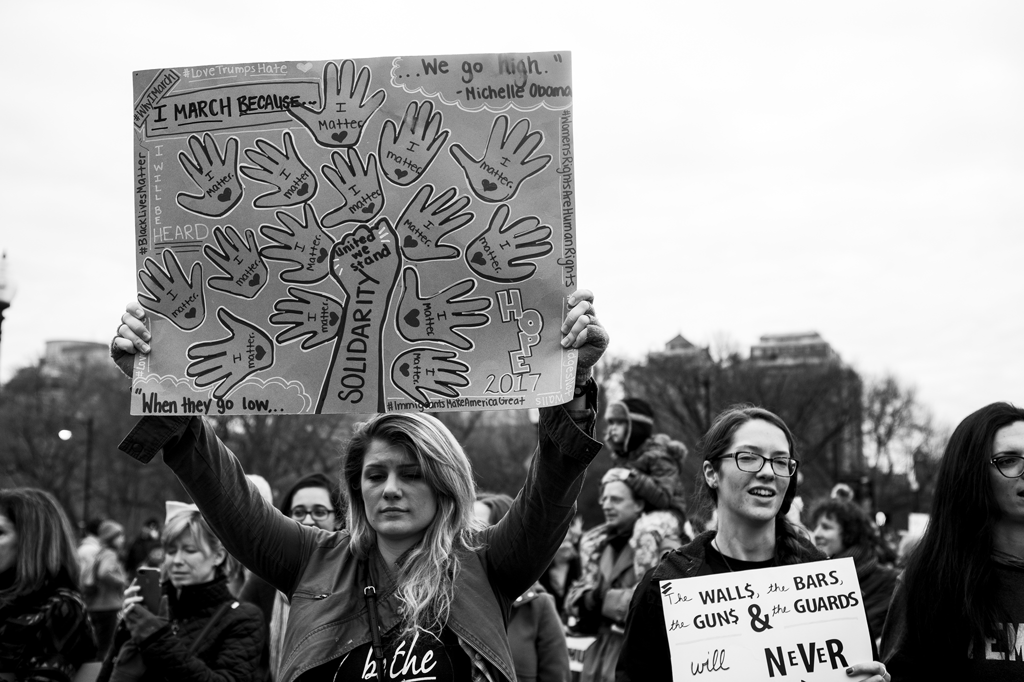 Why I march protest sign held by young blond women at the women's march on washington sister march in boston.