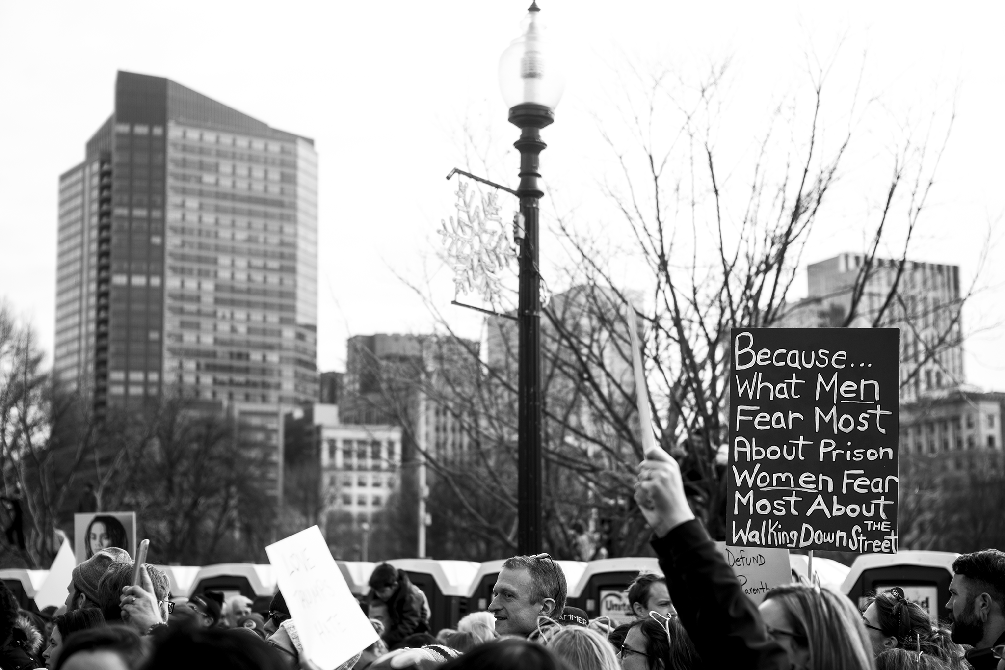 protest sign with skyline at the women's march on washington sister march in boston.