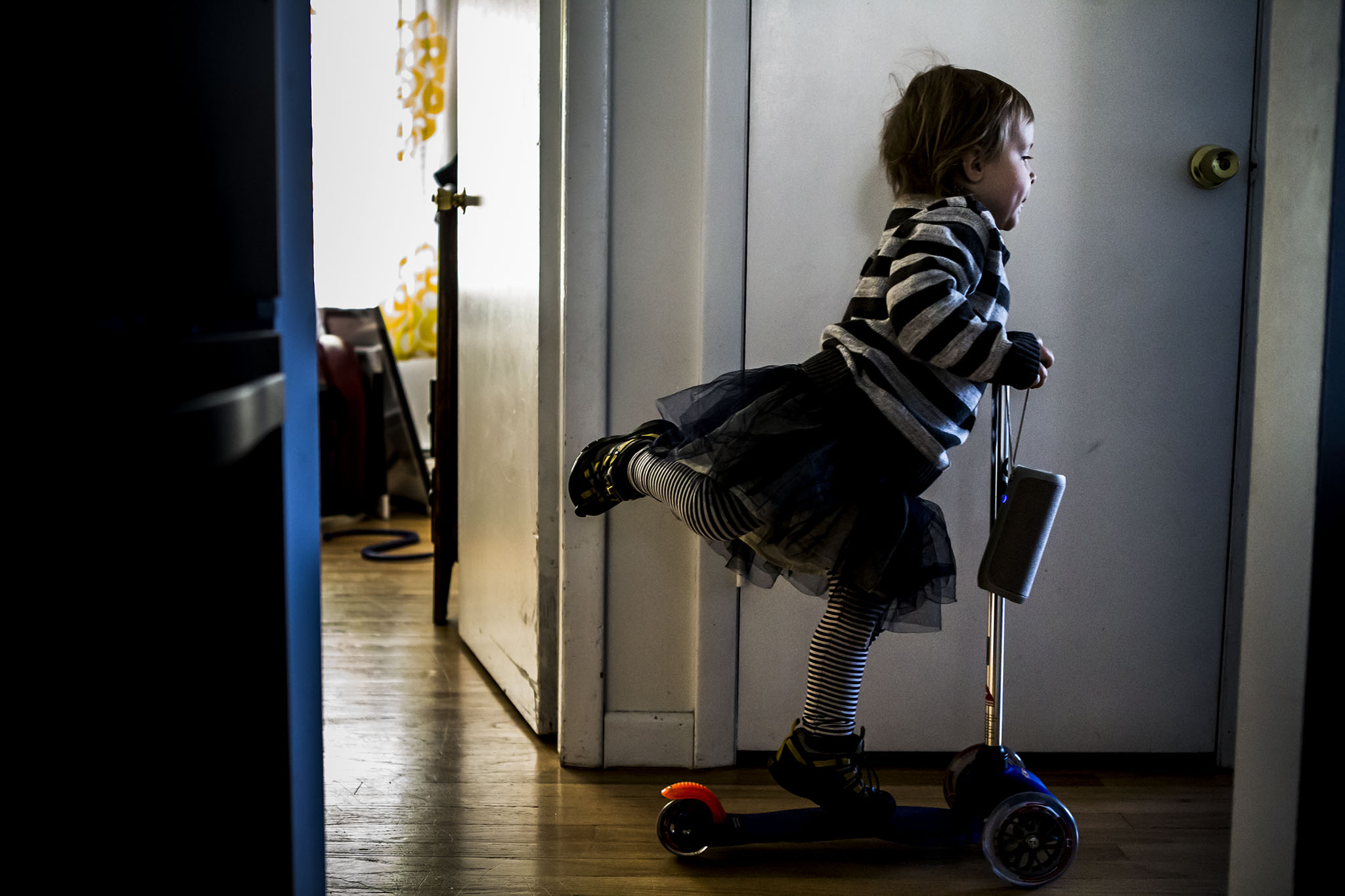 child scooting in house in candid child portrait by ct photographer chelsea silbereis.