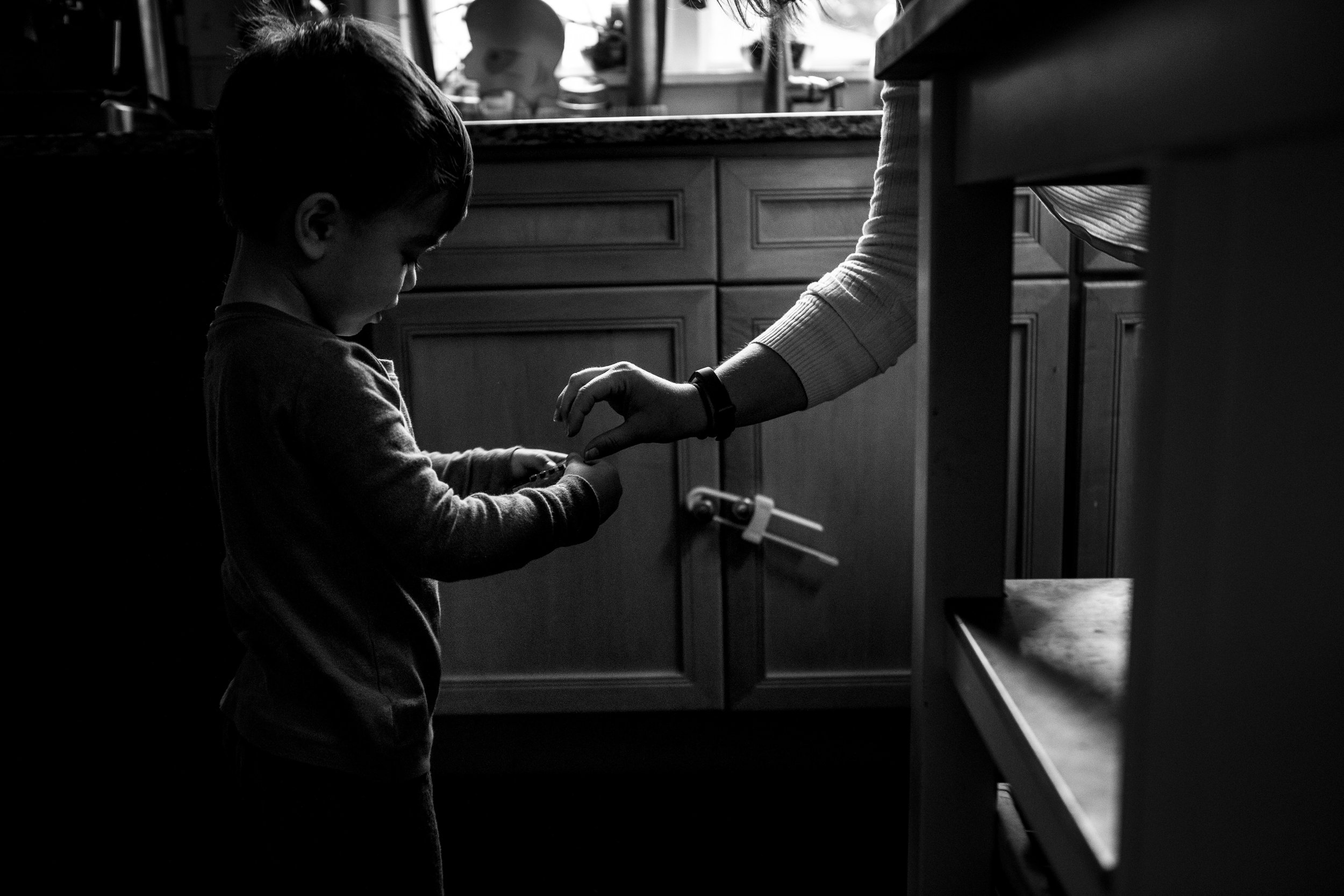 Black and white picture of boston mom cooking with boston kid