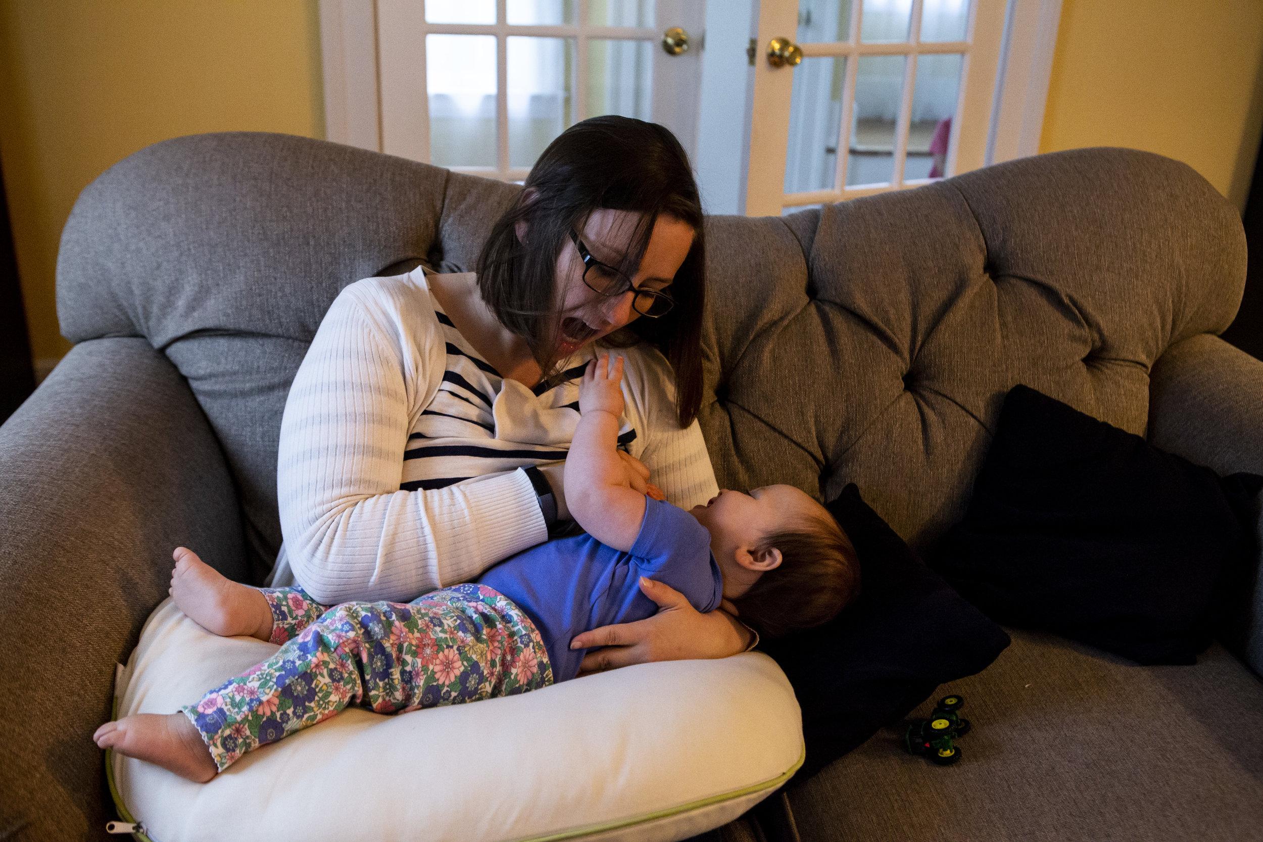 Boston mom playfully breastfeeding her toddler