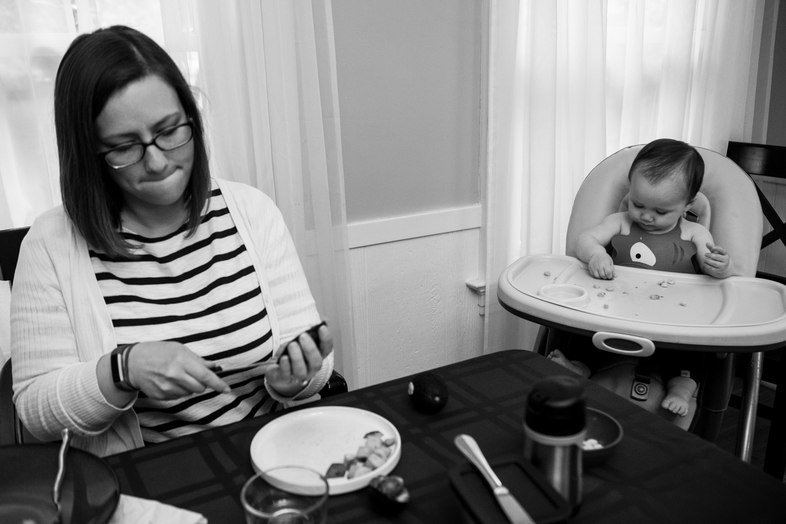 Boston photographer captures family dinner in black and white with mom and toddler in high chair