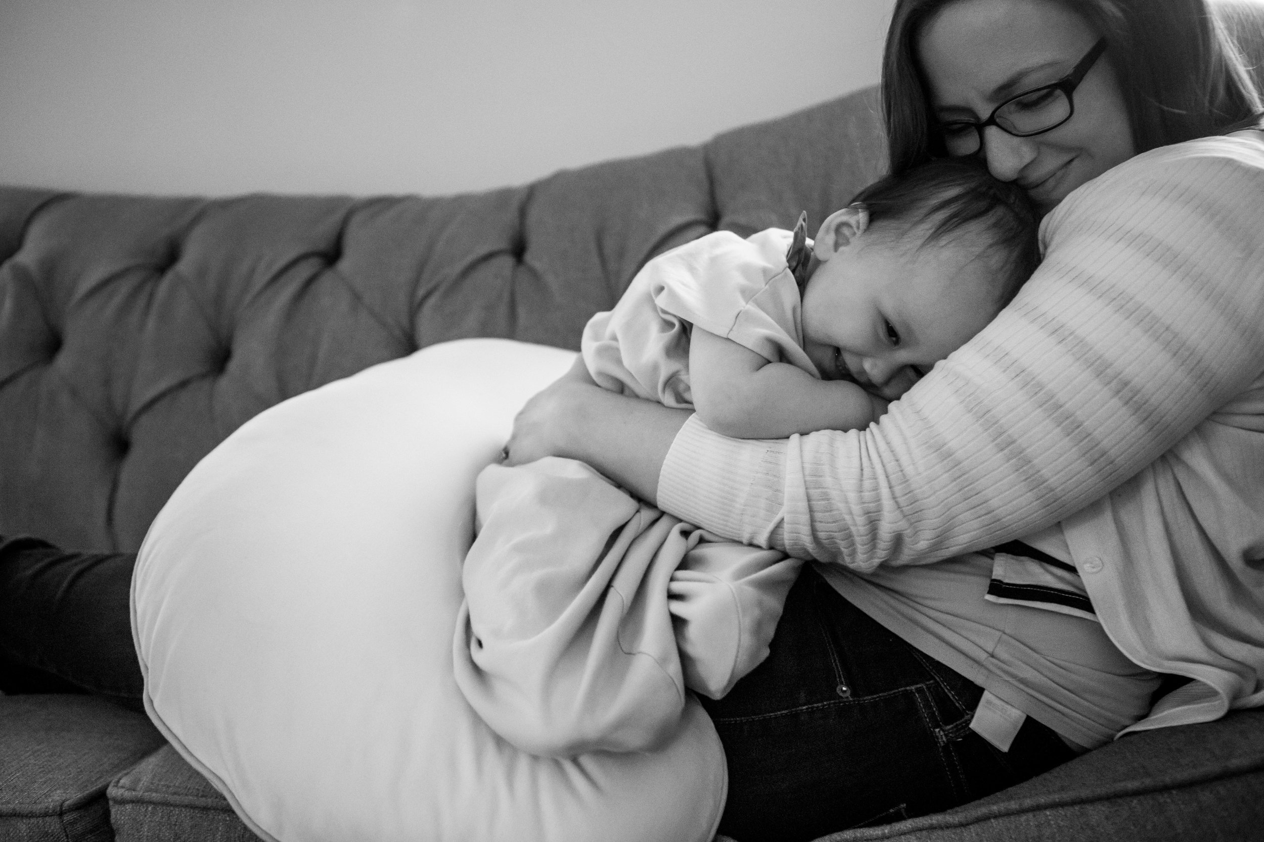 Real Life black and white family photo of boston mom and daughter snuggling on the couch