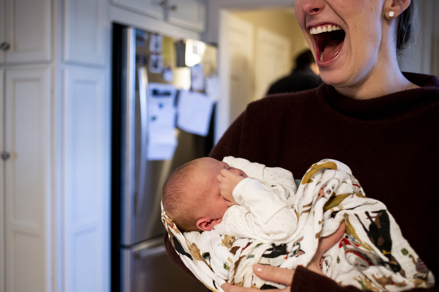 Joyful portrait of newborn motherhood in Boston Massachusetts.
