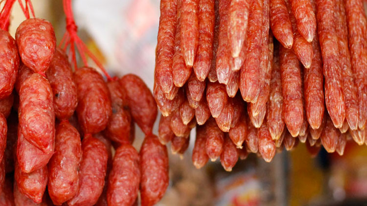Above photo:   Lap cheong  is a dried, hard sausage usually made from pork and a high content of fat. It is normally smoked, sweetened, and seasoned with rice wine and soy sauce
