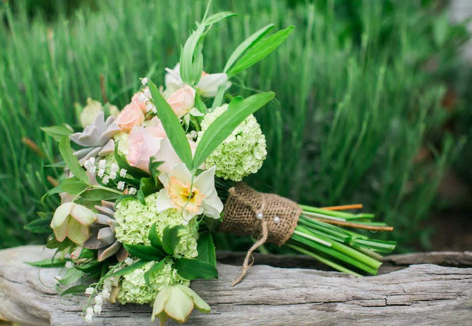 Local bouquet by  Scarborough Farm  including hellebores, viburnum, lily of the valley, sweet pea vine, daffodils, succulents.