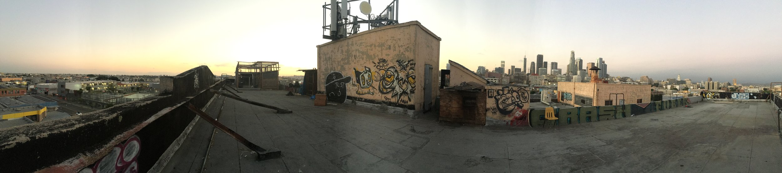 Roof top panorama. Nice view over down town. Note the pigeon cages to the left on the roof. Someone is raising pigeons here. For meat? Post?