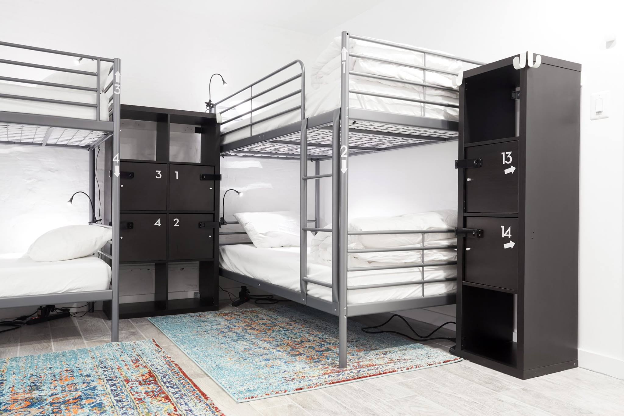 Bunk beds and lockers in backpackers dorm room