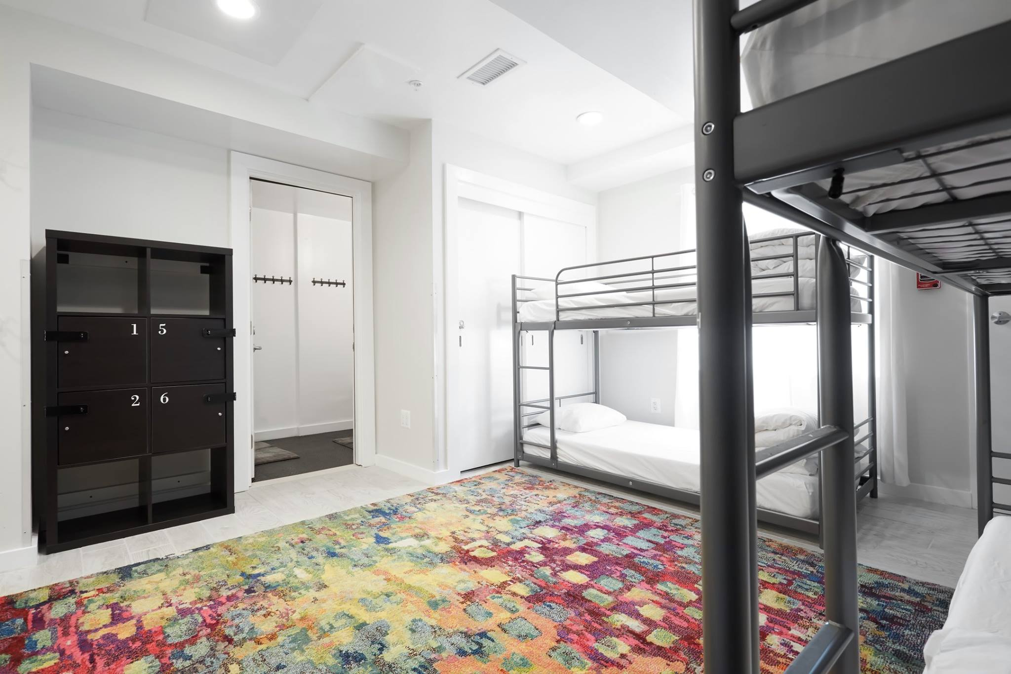 Bunk beds, guest lockers, arranged in a bright shared room