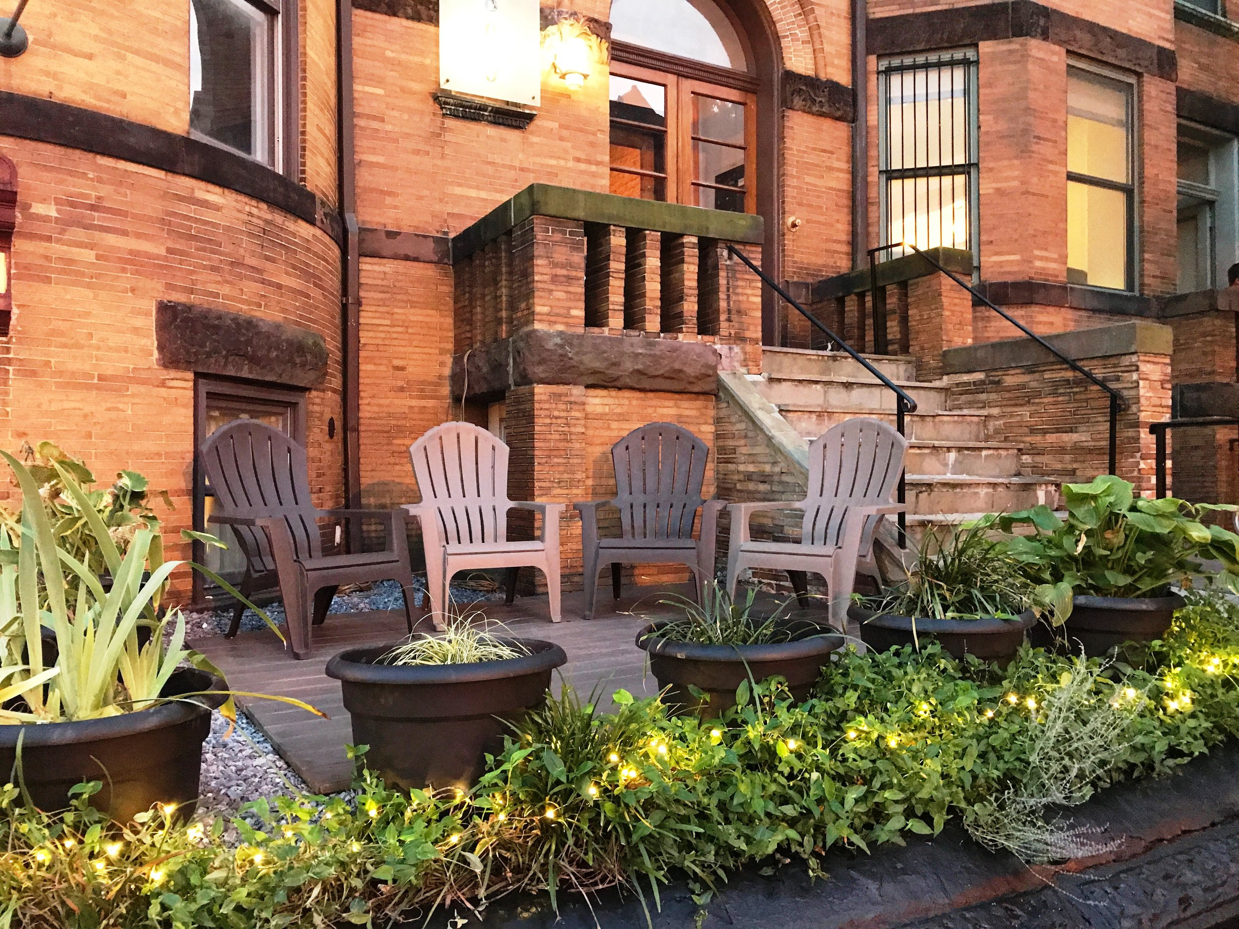 Terrace area with chairs for guest seating outside in front of the building.