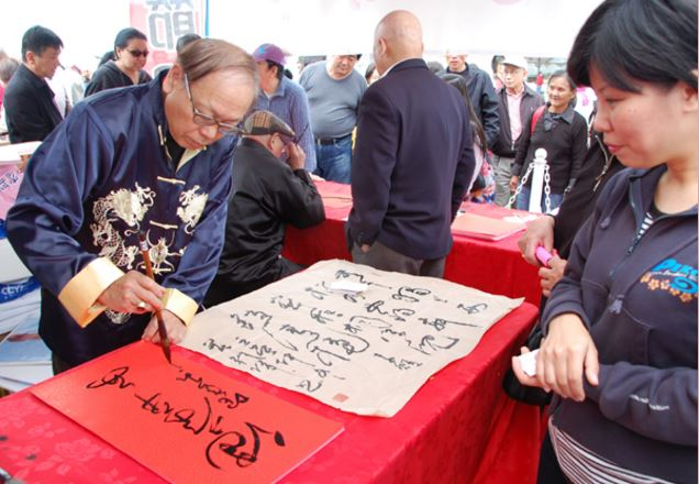 Calligraphy artists writing at the festival.
