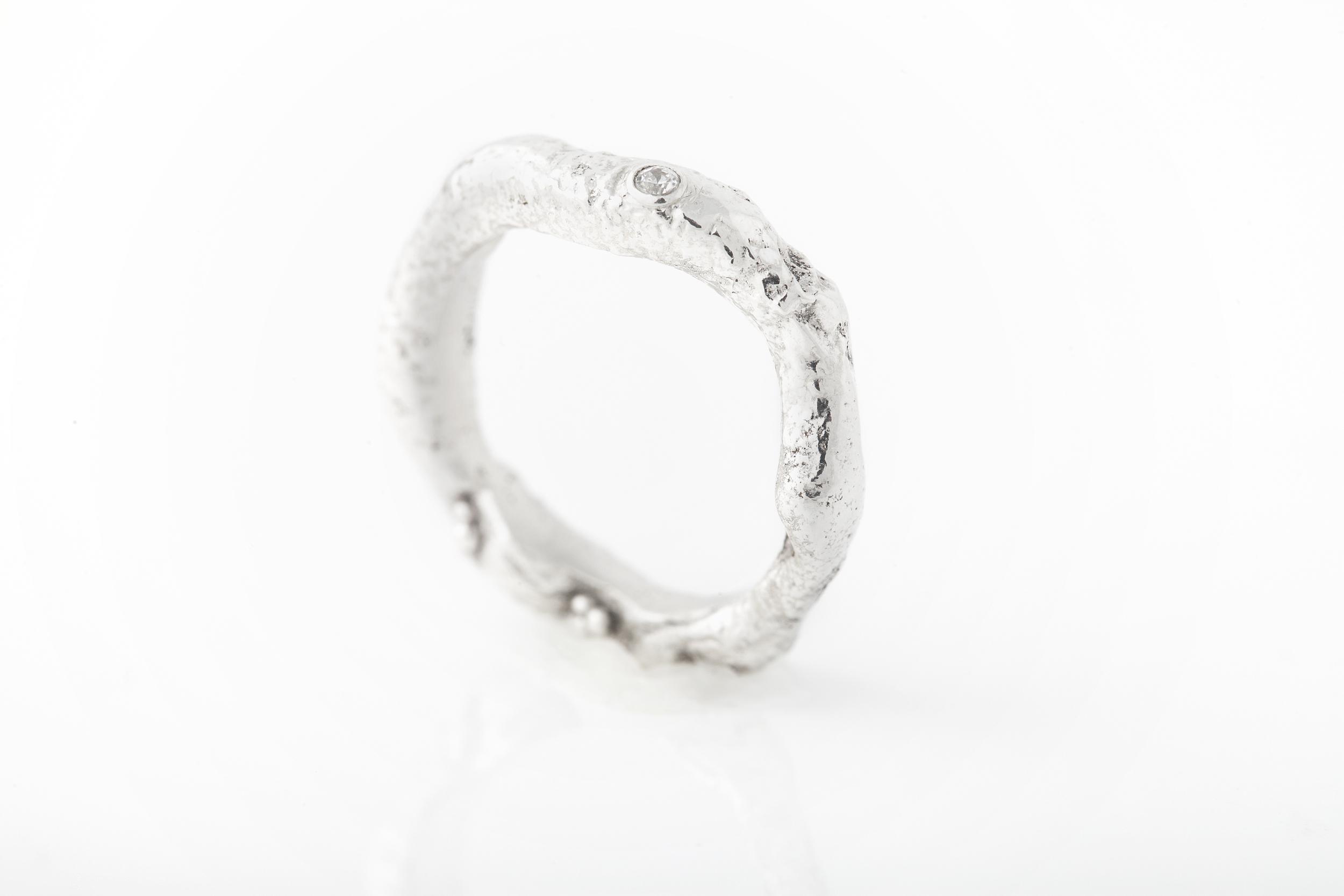 Custom wedding band - Reticulated sterling silver, fine silver granulation, lab-grown diamond.