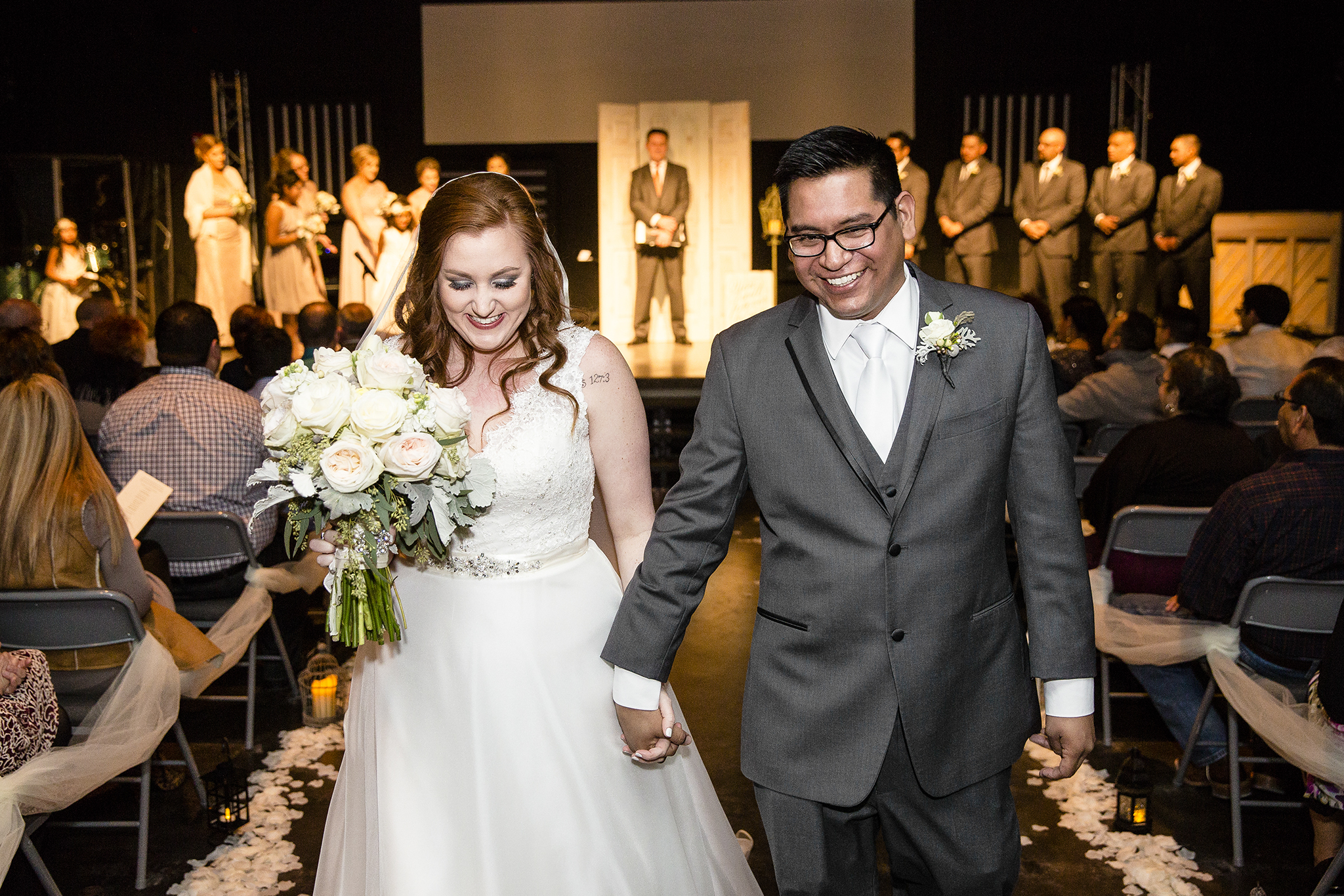 bride and groom leaving the ceremony, newly married, experience life church lubbock texas