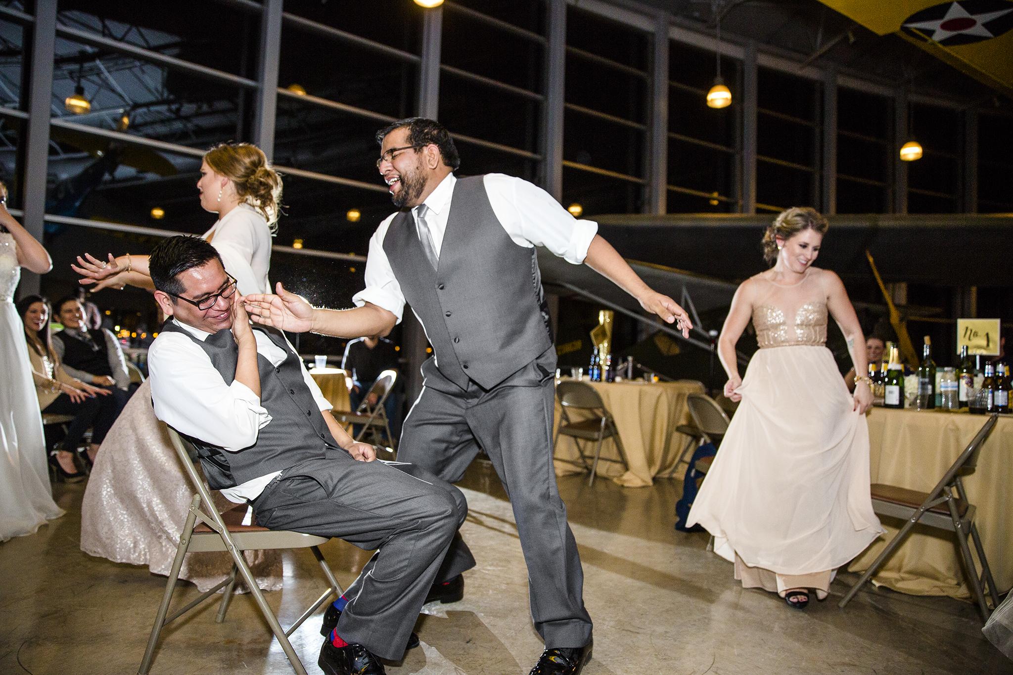 groom lap dance, fun wedding reception, crazy, a little drunk