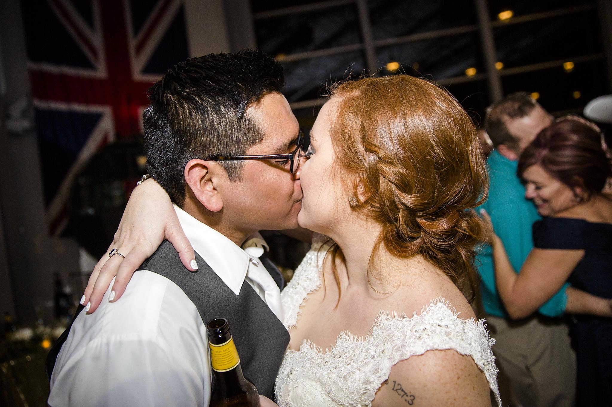 bride and groom kiss, wedding reception, romantic, fun wedding reception