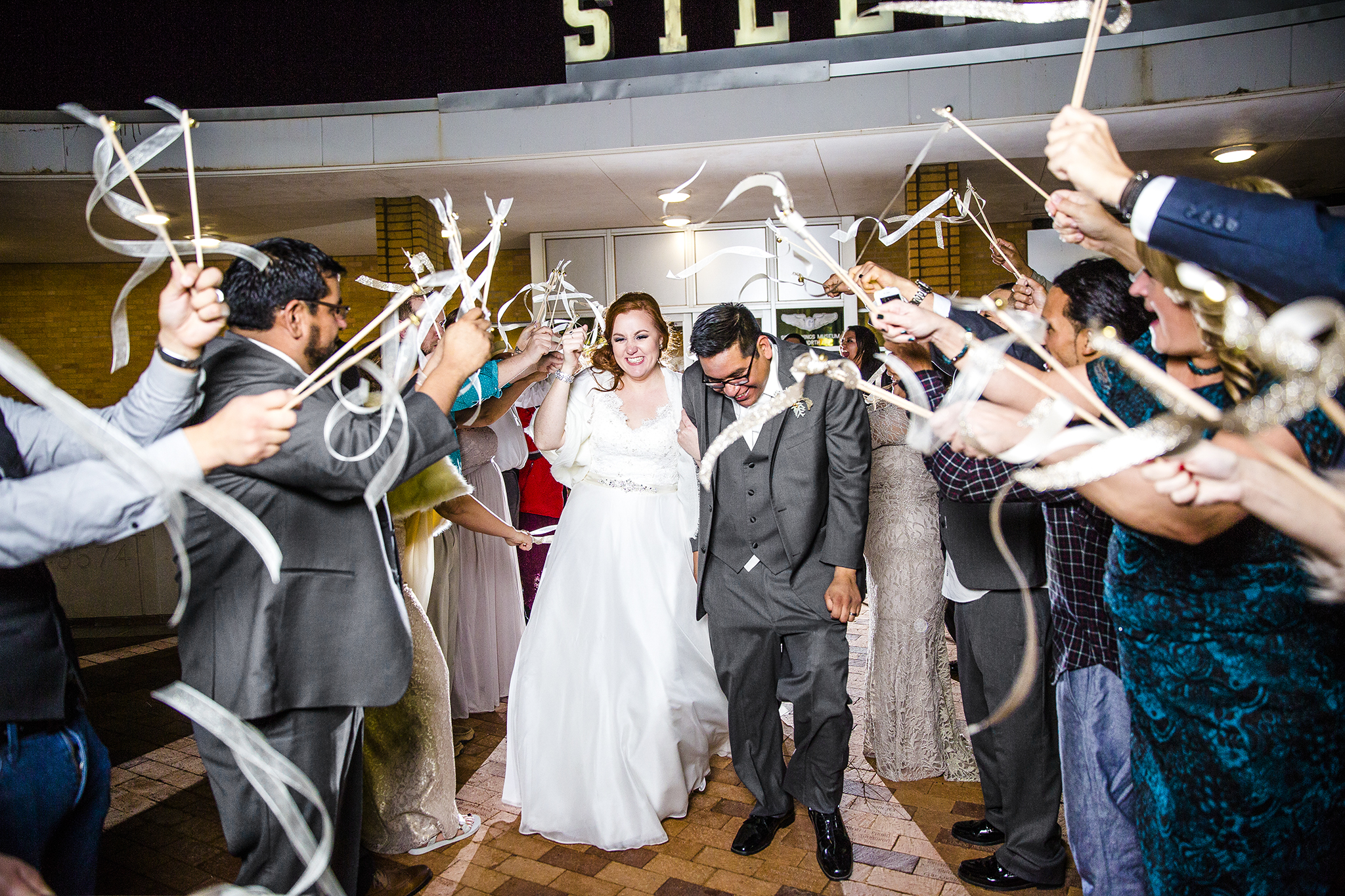 bride and groom, grand exit, ribbon wands, lubbock silent wings museum