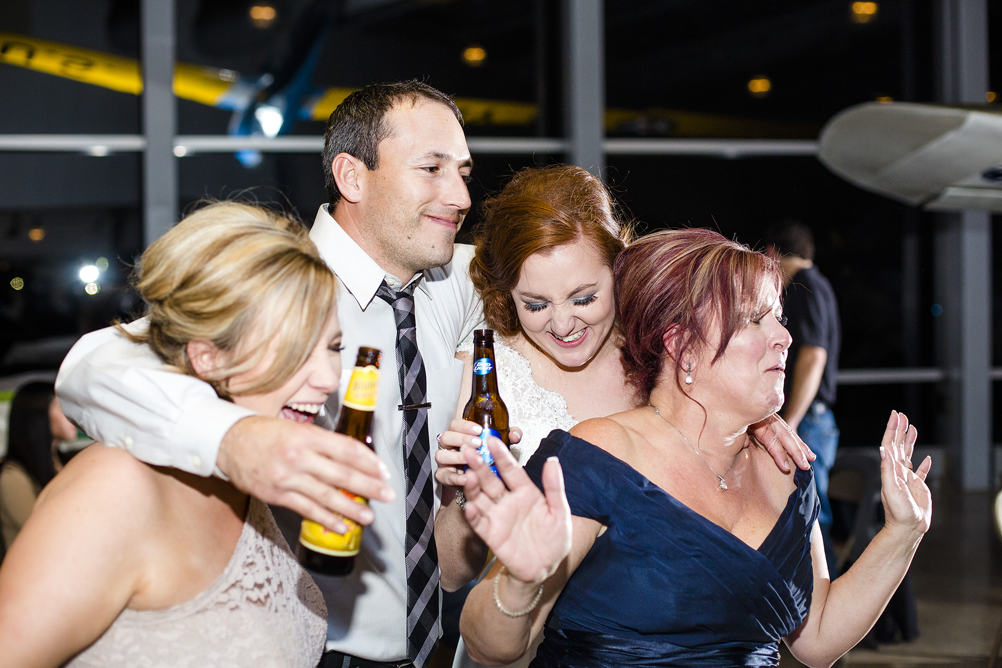 fun dance pictures, wedding reception, having a good time, mother of the bride, sisters of the bride, brother in law