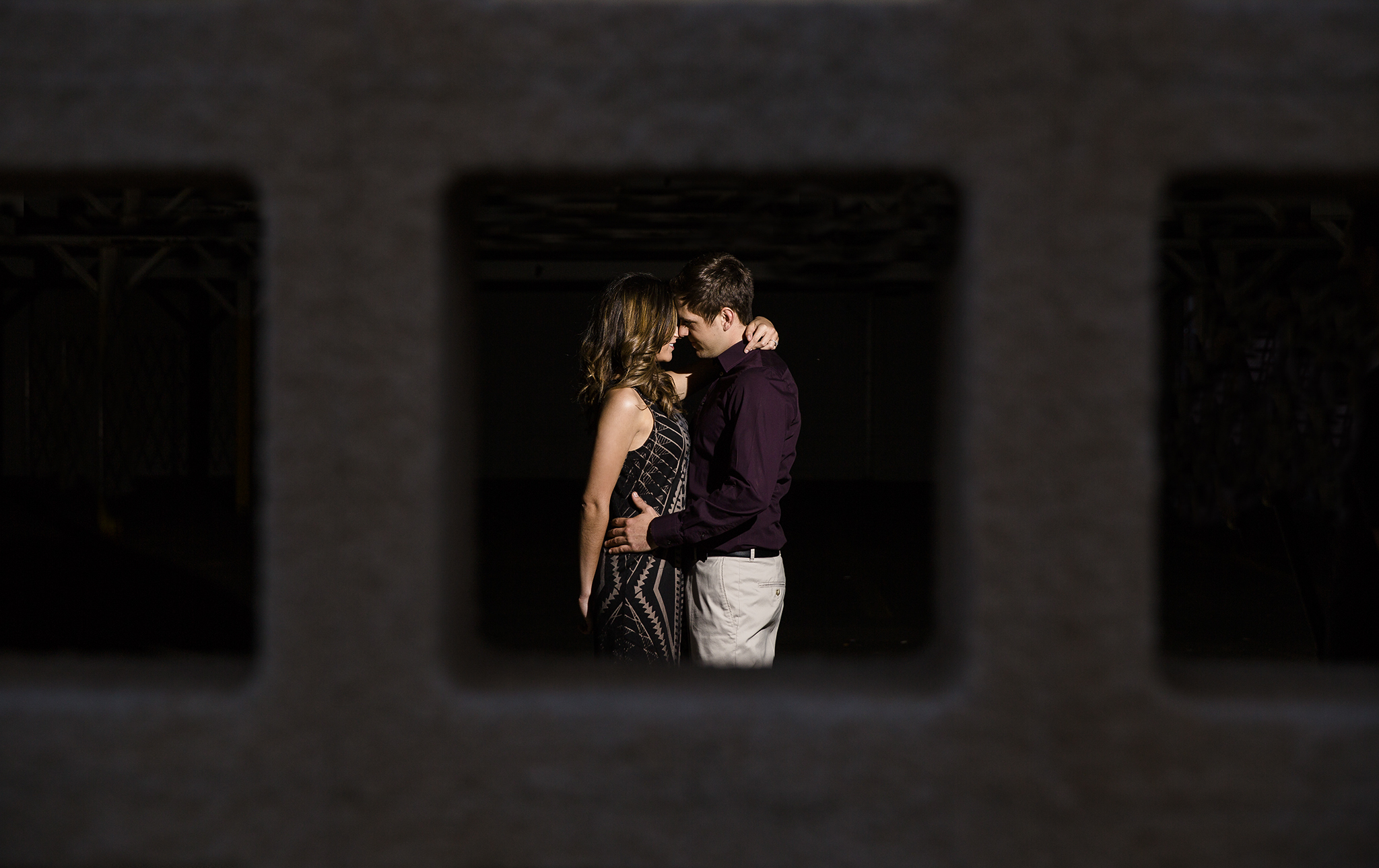 creative framing, shooting through objects, apertures, parking garage architecture, edgy, dramatic, romantic, sexy, kiss me in the dark