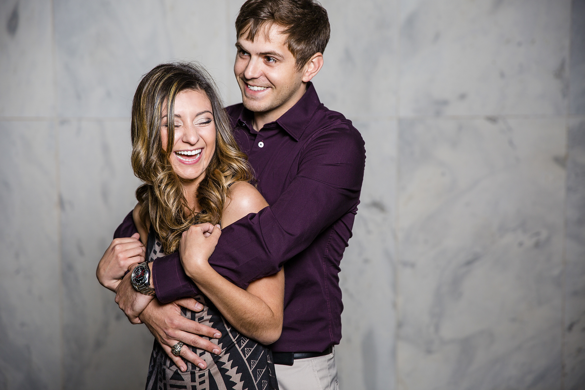 white wall, sweet moments, laughing together, romantic, sweet engagement photography
