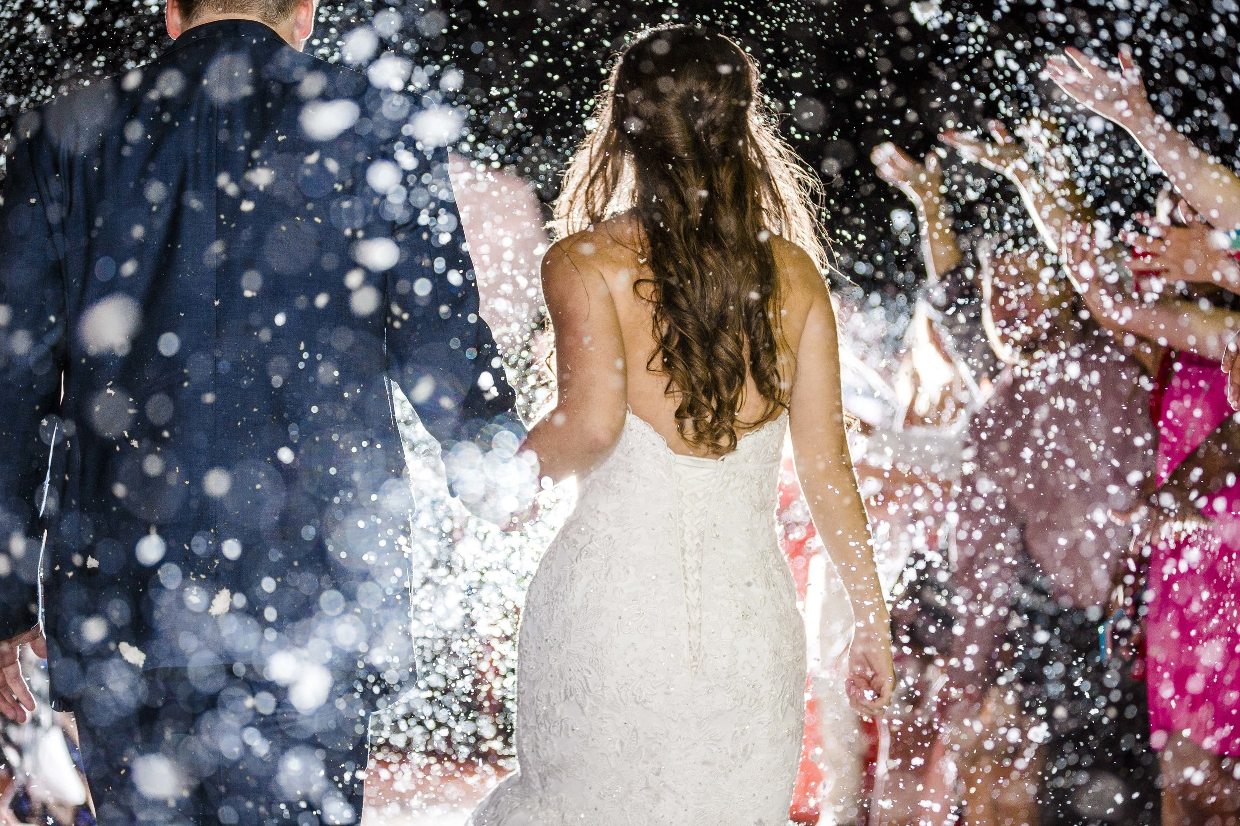 fake snow, the legacy event center, grand exit, lubbock wedding photography, dramatic lighting