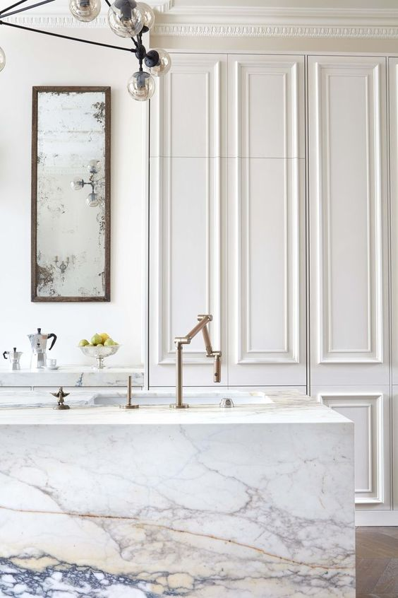 I love a good blend of the simple and the ornate. This kitchen by Blakes London is a solid example of that! But what I love even more, is the use of full-depth, full-height cabinetry and a paneled-out module system, to create this invisible kitchen concept. Obviously things like exposed sinks and faucets will reveal that you're standing in a kitchen, but I think the overall approach is quite clever and super fresh!