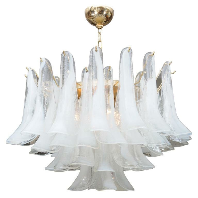 If you didn't know by now, I'm a complete nut for vintage Murano Italian glass! It's a thing of the past (a good thing) and extremely glamorous. I've always been a lover of the Petal leaf chandelier from the 1970's.
