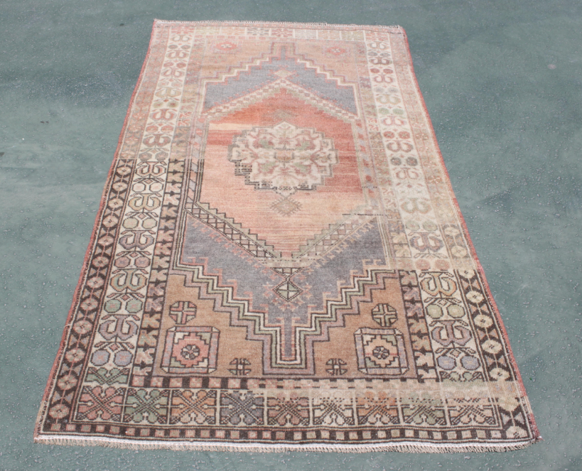 Everyone needs an old rug in their home, everyone. Make it a titty pink geometric one while your'e at it.
