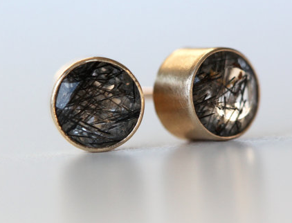 I'm a jewelry connoisseur. Tourmalated quartz earrings. That's all you need to know.