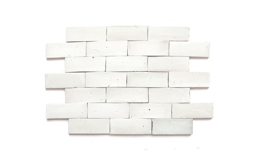 My last rant of the day... Periodically, I'll run across a client who says they want a timeless kitchen or bathroom, but they'll say they don't want the typical subway tile. Of course there are a million different design solutions aside for subway tile (take this pitted, more organic handmade subway tile above for example, or pattern play of the shower below), but let's pause for a second and talk about how timeless subway tile really is!  Yes, it's on trend right now, but that's only because classicism is on trend!AND THANK GOD FOR THAT!  I'm talking, white cabinets, marble this - marble that, white millwork and subway tile. Those are all timeless, classic materials. They will NEVER go out of style, even if that means they're on trend right now.