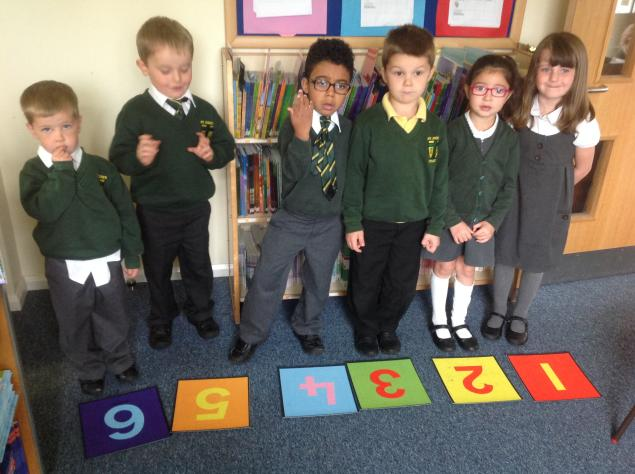In Maths we have been ordering numerals, matching numbers as words and matching numicon tiles to numerals.