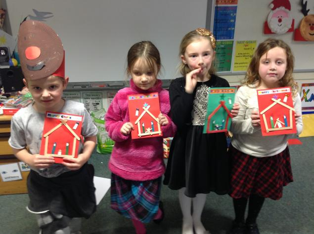 We made a Christmas card nativity scene using lolly sticks.