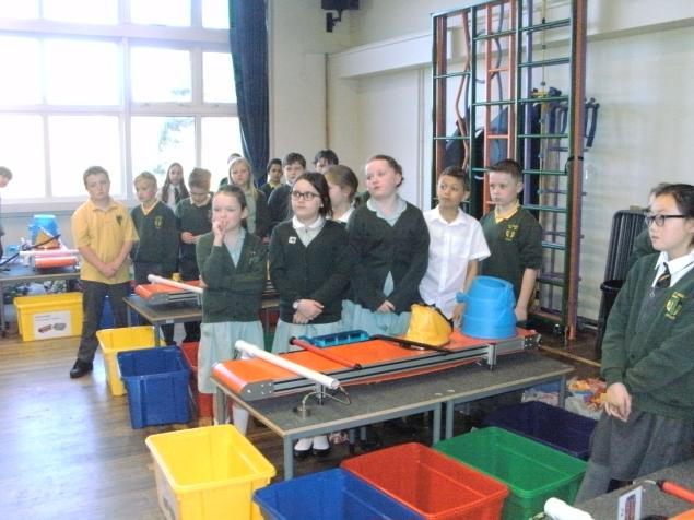 The children stand by their conveyor belts before the sorting begins!